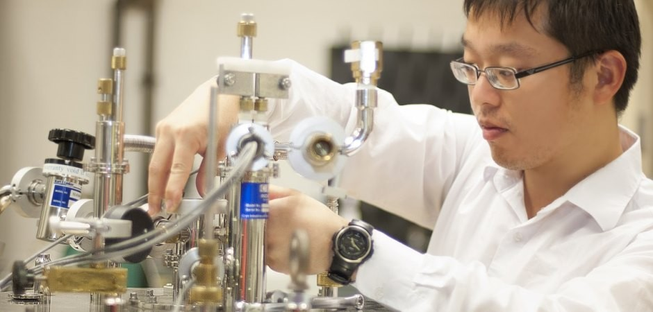 Mr. Haojie Ji, a Ph.D. student, preparing a superconducting<br>magnet for magneto-photoluminescence experiments in<br>Prof. Kuskovsky's Laboratory for Fundamental and Applied<br>Nanoscale Physics (LaFANP)